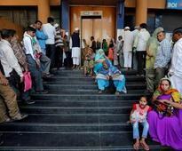 Indians line up at banks to deposit savings or see them disappear