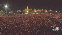 Massive crowds gather in Sanam Luang to sing royal tribute to late HM King Bhumibol