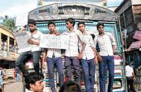Students block road for bypass