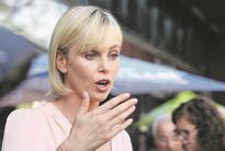Charlize Theron shines at Aids conference
