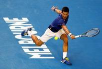 Australian Open: Djokovic eases past Nishikori to set up Federer showdown