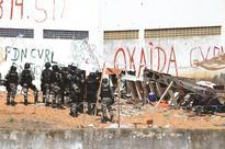 Rival gangs clash inside Brazil massacre prison