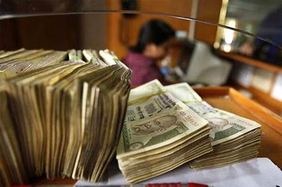 Banks' deposit base to take Rs 1.5-2 lakh cr hit