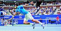 Djokovic in last four as injured Tsonga retires