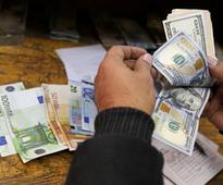 Egyptian importers face bankruptcy after currency float