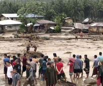Philippines Tropical Storm Tembin: Death toll rises to 133 as rescuers pull dozens of bodies from a swollen river