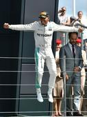 Hamilton wins at Silverstone to cut Rosberg lead