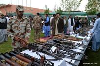 Frontier Corps display weapons seized in operations in Pakistan