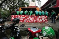 Jakarta's traffic-clogged economy gets a lift from motorbike deliveries