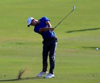 Golf-McIlroy says outing with Trump 'not an endorsement'