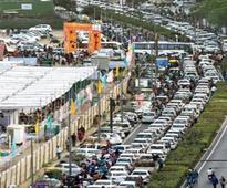 Traffic entangled in kite show; flowers make cops wilt