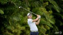 Golf: Thunderstorm stops Spieth as S Korea's Song leads in Singapore