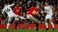Manchester United's Zlatan Ibrahimovic sidelined for a month with knee injury