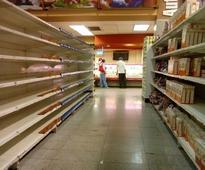 Venezuelan officials and opposition meet mediators over standoff