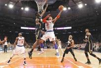 Anthony helps Knicks down Pacers