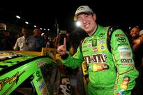 Kyle Busch: NASCAR Sprint Cup Champion Jumps out of His Car During Traffic Jam to Sign a Fan's Hat