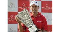 Plucky Aiken holds firm for three-stroke victory in India