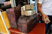 Venezuelans ditch largest bolivar bill before its removal