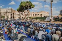 Thousands of Muslims protest outside the Colosseum in Rome