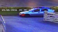 CCTV of a car being driven with a man on the roof released