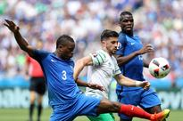 Irish lead France 1-0 at half-time in last 16 Ireland's forward Shane Long (C) and France's defender Patrice Evra ...