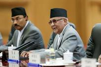 Nepal crisis averted as Maoists remain in coalition