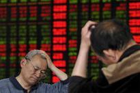 China stocks sag ahead of long holiday; Hong Kong follows Asian markets lower