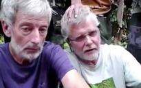 Hostages plead for life in video after Abu Sayyaf threatens beheadings
