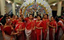 Durga Puja festival ends in a splash of colour