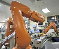 Foxconn replaces more than half of its 110,000 factory workf ...