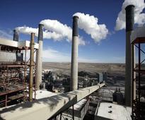 Top court votes along ideological lines to halt Obama's legacy carbon pledge