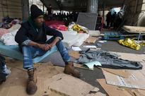 More than 1,000 people evacuated from Paris mi... A migrant sits on a mattress at a makeshift camp in Paris on March 24, 2016....
