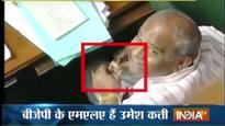 Knataka BJP MLA caught opening tobacco packet inside Assembly