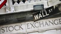 Wall St flat on currency concerns, Microsoft rises to record