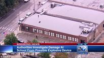 Chicago elementary school is evacuated after a HOLE caused by 'explosive device' is found on roof
