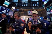 Wall Street loses ground after mixed jobs data