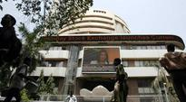 Stocks close with Sensex dropping by 127.97 points