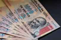 Rupee opens at 67.14 per dollar; down 8 paise