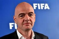 FIFA president Infantino backs doping-tainted Russia, Mutko