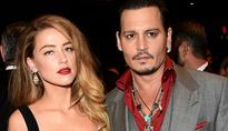 Amber Heard Makes First Public Appearance Since Divorce From Depp Finalized: Is Heard All Smiles While Depp Is Broke?