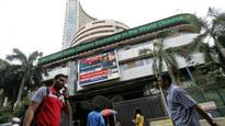 Sensex trades lower over 100 points; Nifty below 7,700-mark