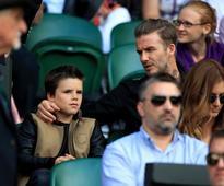 David Beckham's son Cruz yawns through a visit to Wimbledon as he joins his dad and Romeo