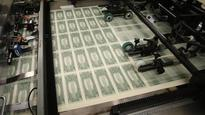Dollar/yen off 1-year low as report show official FX concerns