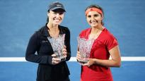 Sania, Hingis secure title no. 11 by winning Sydney International