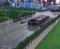 China Unveils Elevated Mass Transit Bus That Drives Over Other Cars