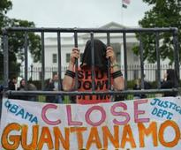 Obama and Heckler Plead to Close Gitmo