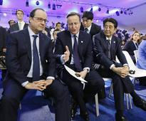 World leaders agree climate deal at COP21 talks