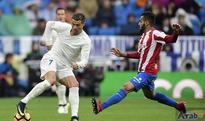 Ronaldo double extends Real lead over Barcelona