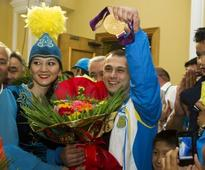 Doping-Ilyin stripped of Beijing, London weightlifting golds