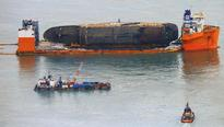 South Korea finds remains of at least one victim of ferry disaster near vessel